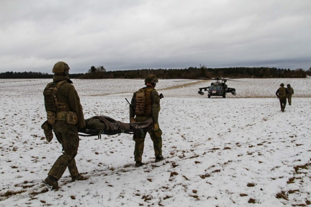PFULLENDORF, Germany -- Special operation forces soldiers from Germany and Norway demonstrate the principles of Tactical Combat Casualty Care on role-playing casualties during the culminating field training exercise of the NATO Special Operations Combat Medic Course, March 1, 2017. This inaugural class, hosted by the International Special Training Centre, is 22-weeks long and covers not just lifesaving intervention but long-term care to prepare these combat medics to deal with any challenge that may arise on future missions. Twenty-three Soldiers representing 10 NATO and partner nations graduated from this NSOCM Course.