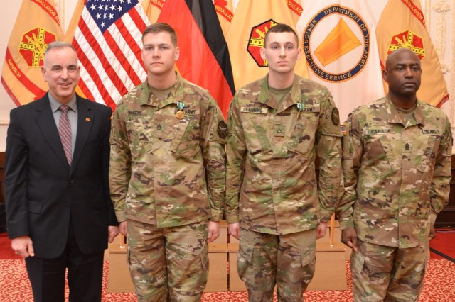 Michael Formica, left, director of Installation Management Command - Europe, and Command Sgt. Maj. Gene Canada, right, IMCOM-Europe command sergeant major, stand with the 2017 IMCOM-Europe Best Warrior Competition noncommissioned officer and Soldier winners during an awards ceremony in Ansbach, Germany, March 23, 2017. Second from left is Staff Sgt. Brendan Hagens of U.S. Army Garrison Wiesbaden, and second from right is Pfc. Douglas Lanning of USAG Benelux.
