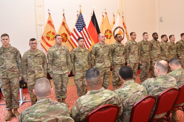 The 13 candidates of the 2017 Installation Management Command - Europe Best Warrior Competition stand together minutes before the winners are announced March 23, 2017, at Bismarck Kaserne in Ansbach, Germany. The two winners are Staff Sgt. Brendan Hagens of U.S. Army Garrison Wiesbaden and Pfc. Douglas Lanning of USAG Benelux.