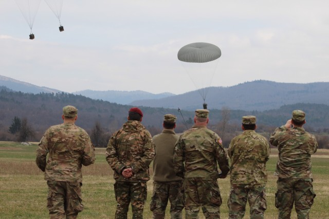 POSTOJNA, Slovenia -- Key leaders of the 16th STB and 157th LOG REG observe the aerial resupply operation delivering supplies including food, water, and ammunition. The 16th Special Troops Battalion (STB) deployed its forces forward to conduct a battalion-level exercise including a convoy live fire exercise (CLFX), explosive ordnance disposal (EOD) and aerial resupply here, March 19.  (U.S. Army Photo by 1st Lt. Mark Schneider, 16th Sustainment Brigade Public Affairs Office)