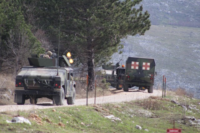 POSTOJNA, Slovenia -- Soldiers of the 16th STB fire rounds to engage targets during the CLFX portion of Vanguard Proof.  The Soldiers trained with their Convoy Escort Teams (CETs) for months leading up to the exercise focusing on basic fundamentals and principles culminating to the final live fire event. The 16th Special Troops Battalion (STB) deployed its forces forward to conduct a battalion-level exercise including a convoy live fire exercise (CLFX), explosive ordnance disposal (EOD) and aerial resupply here, March 19.  (U.S. Army Photo by 1st Lt. Mark Schneider, 16th Sustainment Brigade Public Affairs Office)