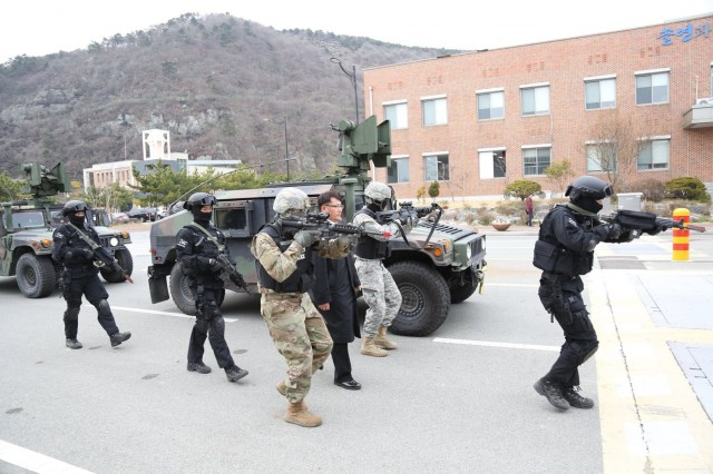 "Soldiers from 188th Military Police Company ""Original Warfighters"" with Republic of Korea Navy Special Duty Team conduct VIP escort training, March 16, 2017, at Busan Naval Base. The training enforced and enhanced joint service interoperability. (Photo by Sgt. Uriah Walker, 19th ESC Public Affairs)"