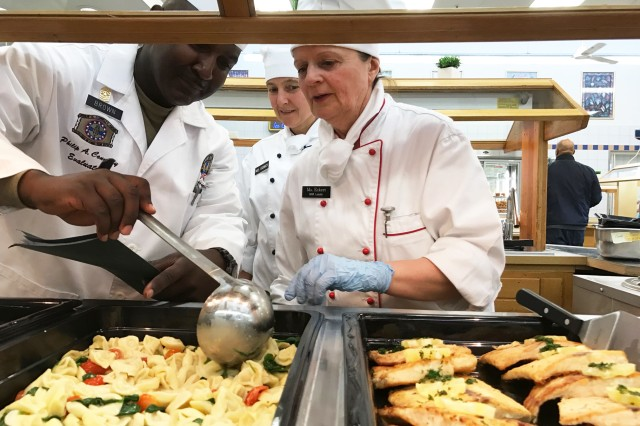 Connelly Award evaluator Sgt. Maj. Anthony B. Brown, left, provides feedback to chefs Andrea Erdwich and Irmgard Eckert. The dining facility at Camp Normandy in Grafenwoehr, Germany, again represents U.S. Army Europe in the 2017 U.S. Army Philip A. Connelly Award competition for excellence in food service.