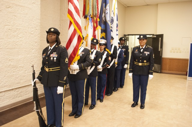 The joint color guard from Rock Island Arsenal prepares to present the colors during the annual Women's History Month observance in Heritage Hall, Rock Island Arsenal, Illinois, March 21.