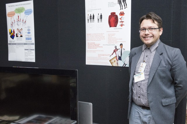 "The Natick Soldier Research, Development and Engineering Center's Bootstrap Initiative provides employees the chance to propose innovative ideas, with employees also given the chance to vote on which ideas proposed by their colleagues will receive funding. Alfredo Lujan (pictured here) -- a clothing designer on NSRDEC's Design Pattern and Prototype Team, presented his proposal, ""We are not squares"" at NSRDEC's Bootstrap Pitch Day. Lujan's idea promotes the benefits of using Kinetic Garment Construction, or KGC, to design military clothing."