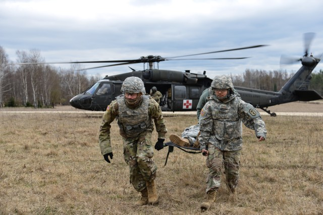 U.S. Soldiers, assigned to the 12th Combat Aviation Brigade, use a UH-60 Blackhawk to conduct training on different Medical Evacuation methods, with U.S. Soldiers, assigned to Public Health Activity Rheinland-Pfalz, at the 7th Army Training Command's Grafenwoehr Training Area, Germany, Mar. 20, 2017. The Soldiers conducted MEDEVAC training to develop the ability to team up with flight medics to safely transport patients by a helicopter.
