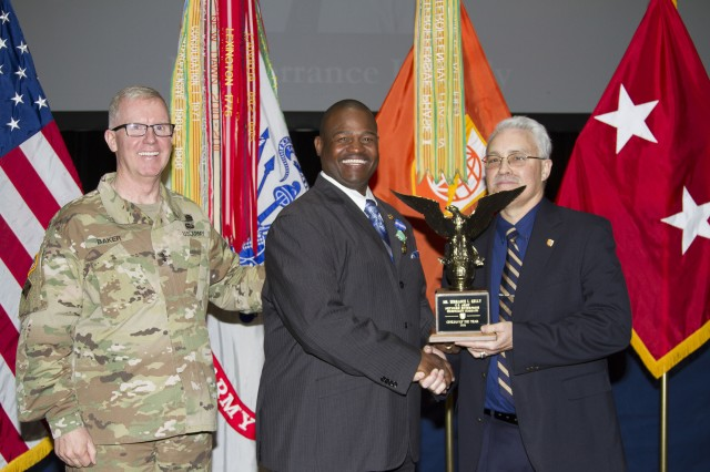 Terrance Kelly (center) receives an eagle statue in recognition of his selection as the NETCOM Headquarters 2016 Civilian of the Year. Presenting the statue to Kelly is Dan Bradford, NETCOM Deputy to the Commander, Senior Technical Director and Chief Engineer, and NETCOM Commanding General, Maj. Gen. John Baker.