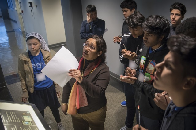 Dr. Madhumita Roy of the U.S. Army Research Laboratory discusses Contact and Nano Lithography to STEM students during National STEM Week at the Lab March 2.