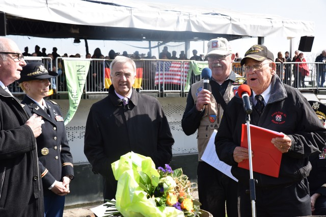 NIERSTEIN, Germany (Mar. 25 2017) -- Robert Shelado, the last living World War II veteran of the first Allied Rhine River crossing at Nierstein, tells his first hand account of the historic assault to a crowd of hundreds at the very site of the event. A joint German and U.S. Army ceremony here memorialized the historic first Rhine River Crossing of World War II, conducted by the 249th Engineer Combat Battalion under the direction of U.S. Army Gen. George Patton March 23, 1945.