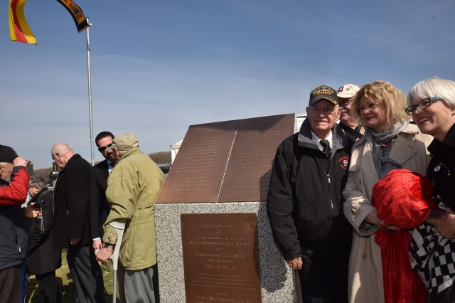 NIERSTEIN, Germany - Robert Shelado, Rhine River Crossing veteran left poses with CAtherine Rommel, granddaughter of German Field Marshall Erwin Rommel and Helen Patton, granddaughter of Gen. George Patton, at the Nierstein Rhine River Crossing Monument after unveiling the plaque.