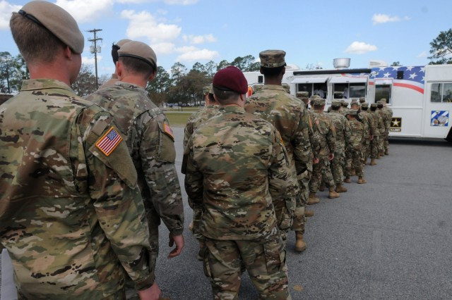 Soldiers line up to order food at the new Army food trucks outside the Marne Reception Center on Fort Stewart March 24. Fort Stewart was a chosen as the location to test the brand new food truck program before it is spread out across the whole Army. (U.S. Army photo by Sgt. 1st Class Ben K. Navratil)