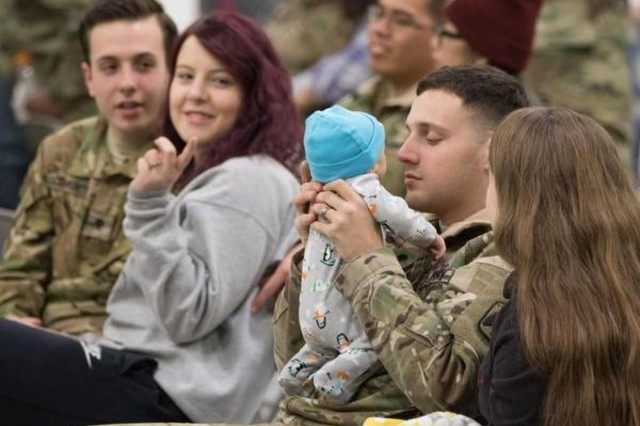 A Soldier says goodbye to his son before the last group of the 16th Combat Aviation Brigade Soldiers from Joint Base Lewis-McChord deploy for Operation Freedom's Sentinel March 19.