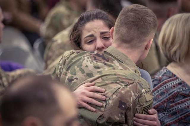 A couple hug before the last group of the 16th Combat Aviation Brigade Soldiers deploy for Afghanistan at Joint Base Lewis-McChord Sunday. The Raptor Brigade has deployed about 800 Soldiers in support of Operation Freedom's Sentinel with U.S. Forces Afghanistan.