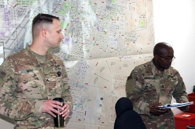 Army Sgt. Kevin Wohl (left), respiratory care specialist, and Army Capt. Grantley Quintyne (right), public health nurse, both Soldiers with the 31st Combat Support Hospital, explain what will occur during the Tobacco Cessation Program's classroom presentation, March 24, at Camp Arifjan, Kuwait. Soldiers participating in the Tobacco Cessation Program are asked to participate in four classroom sessions which emphasize the value of being smoke free to the individual's mind and body.