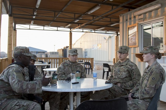 Master Sgt. Samuel W. Gilpin, 1st Theater Sustainment Command, (near left), Staff Sgt. Anthony C. Mills, (center left) and Maj. (CH) James S. Kim, (center), both with the 369th Sustainment Brigade, meet with Capt. Bryan Sunu, (center right) and Spc. Zowie Sprague, (near right), both with the 314th Combat Sustainment Support Battalion, during a Unit Ministry Team battlefield circulation visit in Taji, Iraq, on Feb. 14, 2017. (U.S. Army photo by Sgt. Cesar E. Leon)