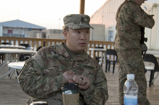 Maj. (CH) James S. Kim, 369th Sustainment Brigade, speaks to Soldiers of the 314th Combat Sustainment Support Battalion Unit Ministry Team during a Unit Ministry Team battlefield circulation visit in Taji, Iraq, Feb. 14, 2017. (U.S. Army photo by Sgt. Cesar E. Leon)