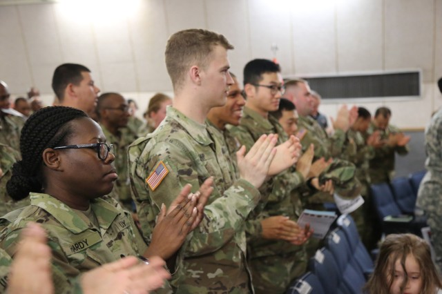 Members of Area IV give a standing ovation to U.S. Army Reserve Maj. Lisa Jaster at the conclusion of her speech at the Women's History Month observance at Camp Henry theater, March 28, 2017. Jaster h