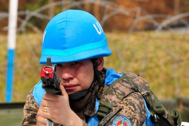 A Mongolian soldier scans his sector during camp defense training at exercise Shanti Prayas III in Nepal. Shanti Prayas is a multinational United Nations peacekeeping exercise designed to provide pre-deployment training to U.N. partner countries in preparation for real-world peacekeeping operations. (U.S. Army photo by Staff Sgt. Michael Behlin)