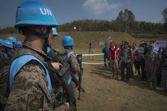 A crowd, acting as protestors, approaches a simulated United Nations camp at exercise Shanti Prayas III in Nepal. Shanti Prayas is a multinational U.N. peacekeeping exercise designed to provide pre-deployment training to U.N. partner countries in preparation for real-world peacekeeping operations. (U.S. Navy photo by Mass Communication Specialist 2nd Class Taylor Mohr)