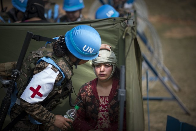 A woman acting as a victim of a bombing is tended to by Mongolian soldiers during training at exercise Shanti Prayas in Nepal. Shanti Prays is a multinational United Nations peacekeeping exercise designed to provide pre-deployment training to U.N. partner countries in preparation for real-world peacekeeping operations. (U.S. Navy photo by Mass Communication Specialist 2nd Class Taylor Mohr)