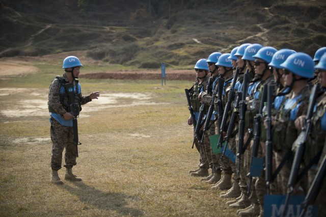 A platoon of Mongolian soldiers stand in formation as they receive a brief after their training at exercise Shanti Prayas in Nepal. Shanti Prays is a multinational United Nations peacekeeping exercise designed to provide pre-deployment training to U.N. partner countries in preparation for real-world peacekeeping operations. (U.S. Navy photo by Mass Communication Specialist 2nd Class Taylor Mohr)