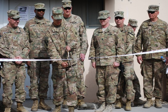 Pvt. Anthony Medieros of the 22nd Human Resources Company cuts the ribbon symbolizing the beginning of operations at Fenty Satellite Post Offices (SAPO), February 27, 2017.