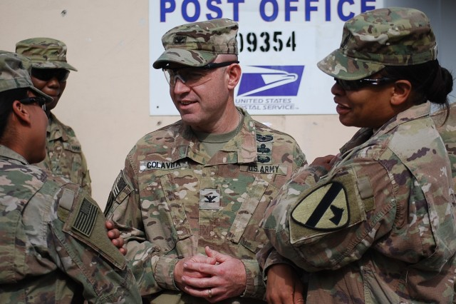 Col. Christopher H. Colavita, commander 1st Cavalry Division Resolute Support Sustainment Brigade (1CD RSSB) and Command Sgt. Maj. Jill L. Crosby of the 1CD RSSB interact with Soldiers at the opening of the Fenty Satellite Post Offices (SAPO), February 27, 2017.