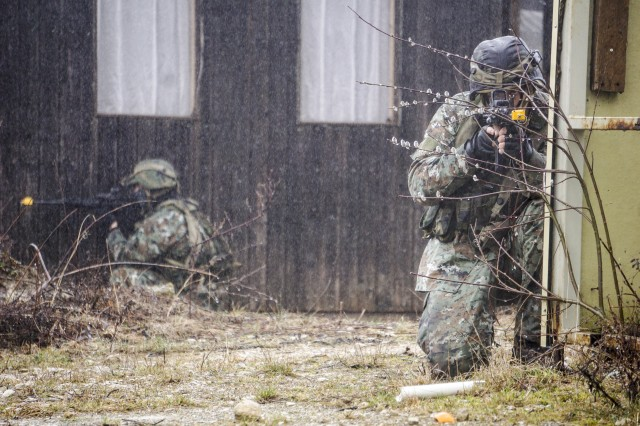 Macedonian special operation forces pull security in freezing rain during an operation in a simulated town at the Joint Multinational Readiness Center in Hohenfels, Germany, March 19, 2017. This operation was part of exercise Allied Spirit VI which integrates multinational special operation forces and conventional forces training towards combined interoperability and interdependence
