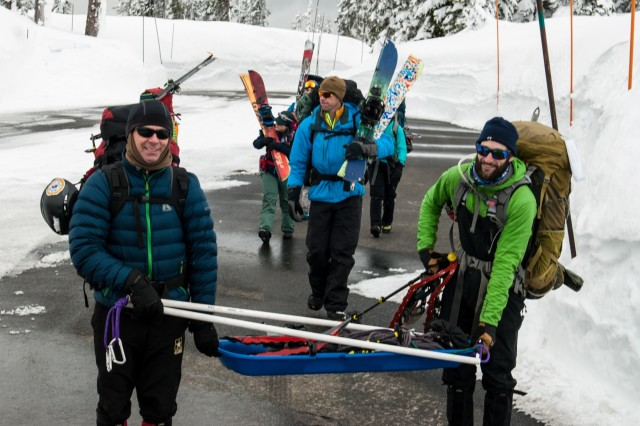 Mark Deschenes, left, and Derrick Pierson, carry a sled loaded with supplies at Mount Rainier National Park, Washington March 4, 2017. The basic alpine course is designed to give students a taste of mountaineering as well as the skills needed to participate in their first guided climb (U.S. Army Reserve Photo by Spc. Sean Harding/Released).