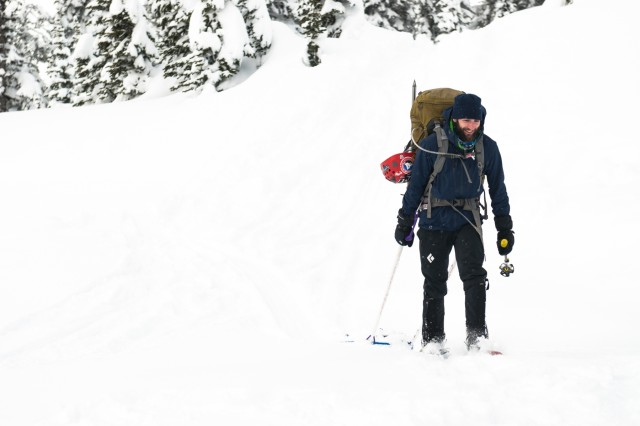Alpine guide Derrick Pierson uses snowshoes to walk to his destination during the practical portion of the JBLM Alpine Club basic alpine course, Mount Rainier National Park, Washington, March 5, 2017. The basic alpine course is designed to give students a taste of mountaineering as well as the skills needed to participate in their first guided climb (U.S. Army Reserve Photo by Spc. Sean Harding/Released).