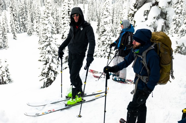 John Dorman, left, explains backcountry skiing safety, at the JBLM Alpine Club basic alpine course, Mount Rainier National Park, Washington, March 5, 2017. The basic alpine course is designed to give students a taste of mountaineering as well as the skills needed to participate in their first guided climb (U.S. Army Reserve Photo by Spc. Sean Harding/Released).