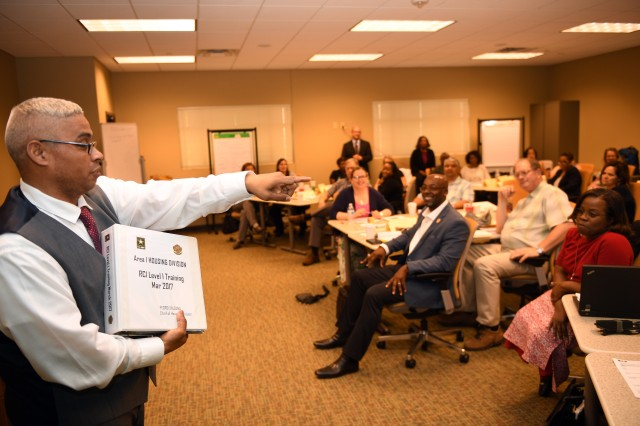 Pedro Saldana, Chief of Army Housing at Camp Red Cloud, South Korea, in U.S. Forces Korea Area I, fields questions following his presentation at the inaugural Residential Communities Initiative training course March 22 at the College of Installation Management on Fort Sam Houston, Texas.