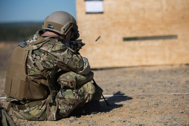 nc a special operations forces sniper engages targets through an obstacle