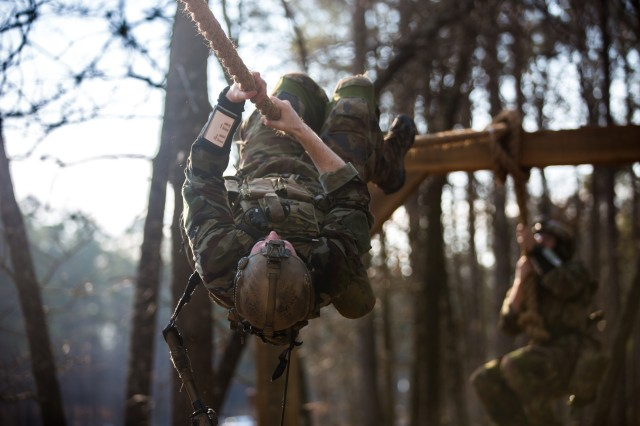 FORT BRAGG, N.C. -- A foreign-partner sniper team navigates across a rope bridge during the United States Army Special Operations Command's International Sniper Competition, where 23, two-man teams from special-operations, foreign-partners and law enforcement agencies put their skills to the test, March 20-24. (Photo courtesy of USAJFKSWCS)