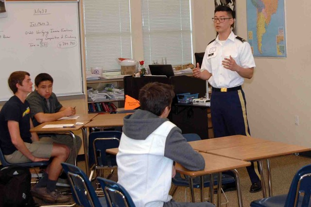 CARMEL, California -- First Lt. Alexander Kim, Company F, 229th Military Intelligence Battalion, speaks to Carmel High School students about her Army service during the school's Career Day.