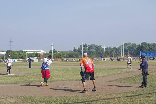 Sgt. Phillip Wyatt swings his bat during the Amateur Softball Association International Pangaea Cup game in Angeles City, Philippines