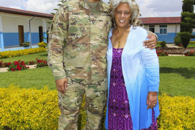 Master Sgt. Bakaffa Casey, an information technology manager with U.S. Army Africa, and his mother, Ferehiout Alemayehu Casey, whom his has not seen in since 1999, pose for a photo after having lunch at the Peace Support Training Center in Addis Ababa, Ethiopia. Casey was able to reunite with his mother, and extended family members, because he was here in support of Justified Accord 17, which was held Mar. 20-24, 2017. JA17 is an annual weeklong joint exercise that brings together U.S. Army personnel, African partners, allies and international organizations to promote interoperability between participating nations for peacekeeping operations in the East Africa region. (U.S. Army Africa photo by Staff Sgt. Lance Pounds)