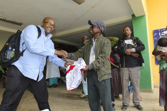 Larry Robinson, exercise security planner with U.S. Army Africa, makes a donation of more than 400 articles of clothing and shoes to survivors of the Mar. 11 landslide that killed 113, at a donation collection camp in Addis Ababa, Ethiopia, Mar. 17,2017. Robinson is in Addis Ababa for the USARAF-led exercise Justified Accord 17, which is an annual joint exercise that brings together U.S. Army personnel, African partners, allies and international organizations to promote interoperability between participating nations for peace keeping operations in the East Africa region. (U.S. Army Africa Photo by Staff Sgt. Lance Pounds)