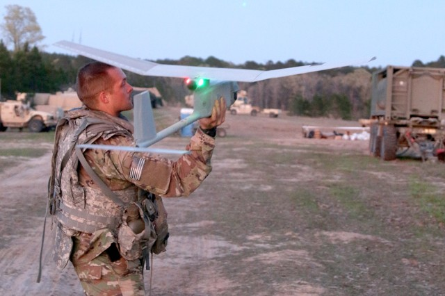 A Soldier with 3rd Brigade Combat Team, 10th Mountain Division (LI) prepares to launch a RQ-11B Raven Small Unmanned Aircraft System during the recent Mountain Peak exercise at Fort Polk, La. Throughout the exercise, the Raven system acted as a combat multiplier, increasing battlefield awareness and providing real-time intelligence on enemy units.