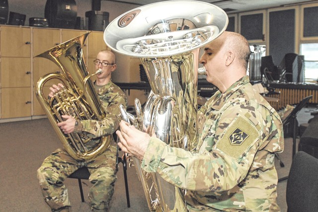 From left, 399th Army Band tuba players, Staff Sgt. Daniel Aston and Sgt. 1st Class James Cipriano, practice in the band's main rehearsal room. Aston and Cipriano represented the band and the Army at two regional collegiate conferences.
