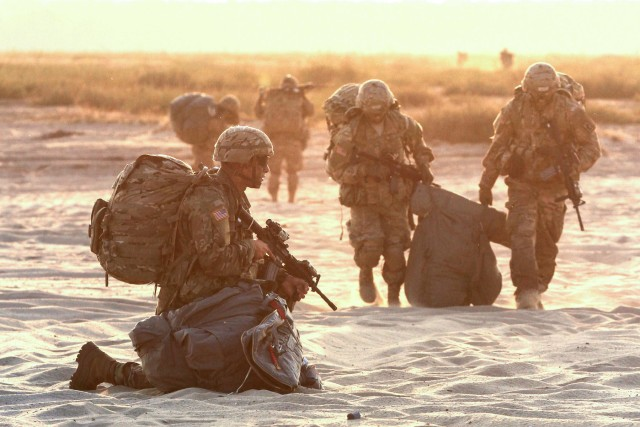 Paratroopers prepare to move from the drop zone