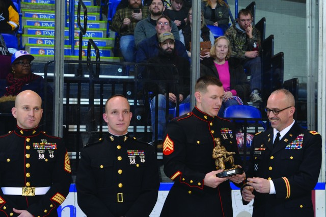 Marine Sgt. Christopher Schell (third from left) was named Tobyhanna Army Depot's Warfighter of the Quarter during a ceremony at a Wilkes-Barre/Scranton Penguins hockey game.  Depot commander Col. Gregory Peterson, far right, presided.