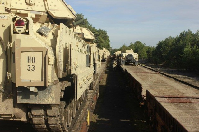 "U.S. Army Soldiers from 4th Squadron, 10th Cavalry Regiment, load tactical vehicles onto rail cars at Sweitoszow, Poland, March 23, 2017, in preparation for the unit's move to Grafenwoehr Training Area, Germany. The ""Black Jack"" Squadron is among the approximately 1,200 Soldiers with 3rd Armored Brigade Combat Team, 4th Infantry Division, departing Poland to participate in the U.S. Army Europe-directed Combined Resolve VIII multinational exercise that will be held from Apr. 19 to June 16 at Grafenwoehr and Hohenfels training areas."
