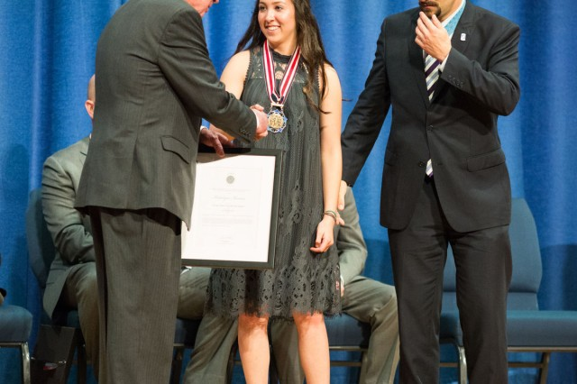 Katelyn Ibarra receives the National Medal of Honor Society's Citizen Honor Award from Medal of Honor recipients Thomas G. Kelley, left, president of the Congressional Medal of Honor Society, and Salvatore Giunta at a ceremony at The U. S. Army Band headquarters, Brucker Hall, Fort Myer, March 25.