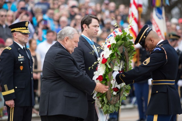 From left, Maj. Gen. Bradley A. Becker, commanding general, Joint Force Headquarters - National Capital Region and Military District of Washington, Medal of Honor recipients Mike Fitzmaurice, Will Swenson and Tomb Guard Staff Sgt. Kevin E. Calderon participate in a wreath-laying ceremony commemorating National Medal of Honor Day at the Tomb of the Unknown Soldier in Arlington National Cemetery March 25.