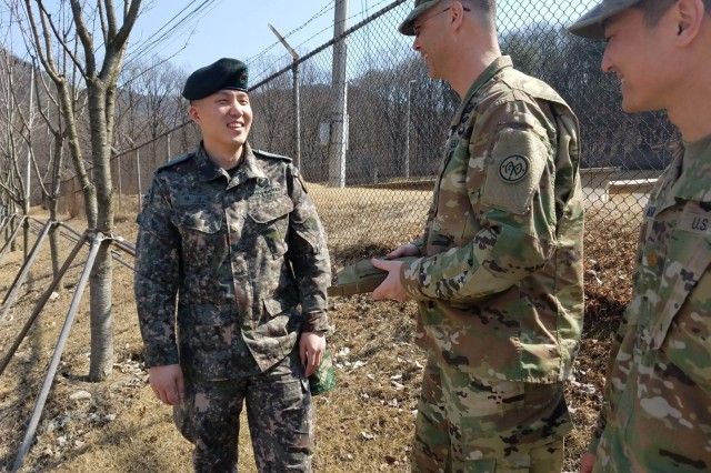 South Korean Maj. Seonghoon Hwang, operations planner with the Republic of Korea armed forces, discusses the support of New York Army National Guard Soldiers with Lt. Col. Jamey Barcomb, the commander of the 27th Infantry Brigade Combat Team staff elements deployed in support of Operation Key Resolve at Camp Casey, South Korea March 15, 2017. Barcomb led a team of staff officers and NCOs to replicate a brigade element as part of the 2nd Infantry Division command post exercise for Key Resolve.