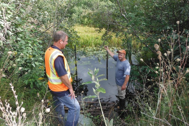 U.S. Army Corps of Engineers, Buffalo District employee Dave Mitchell (left) and Fort Drum employee Scott Siegfried (right) on site at Airfield Creek, as part of the effort to develop conceptual designs aimed to reduce erosion that poses possible risk of future flood events on the base at Fort Drum.