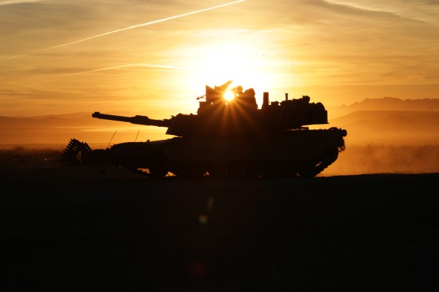 U.S. Army Soldiers, assigned to 3rd Brigade Combat Team, 1st Cavalry Division, maneuver their M1A2 Abrams tank to avoid indirect fire during training at the National Training Center at Fort Irwin, California, Oct. 7, 2016.