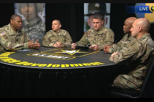 Command Sgt. Maj. Michael Gragg, far left, with the Center for Initial Military Training, discusses the Expert Action Badge during a virtual town hall hosted by the Army Training and Doctrine Command March 30, 2017. If approved, Soldiers would compete in 30-plus warrior tasks and battle drills, as well as up to five mental tasks, for a chance to wear the badge on their uniforms, similar to the Expert Infantryman Badge or Expert Field Medical Badge.