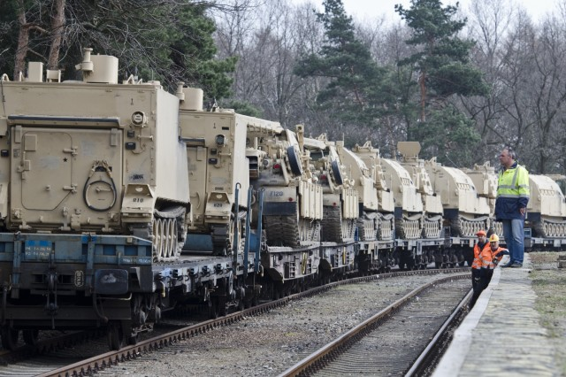 Tracked vehicles belonging to 3rd Battalion, 29th Field Artillery Regiment, 3rd Armored Brigade Combat Team, 4th Infantry Division, moves forward to switch tracks to be offloaded in Zagan, Poland March 29, 2017. The U.S. Field Artillery unit showcases its ability to deter aggression and assure NATO Allies by demonstrating the speed and efficiency at which it can rotate troops and equipment throughout the European theater. (U.S. Army photo by Sgt. Justin Geiger)